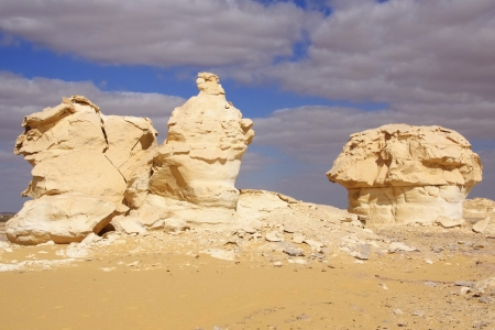 Wind and sand modeled rock sculptures in White desert  Stock Photo