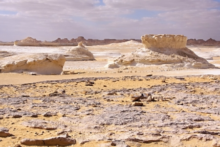 Golden sand on the white marl and calcite formations  photo