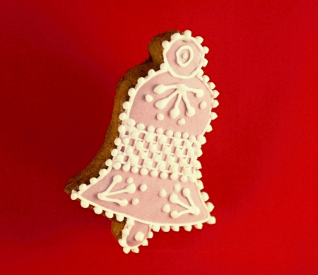 Christmas gingerbread on red background  photo