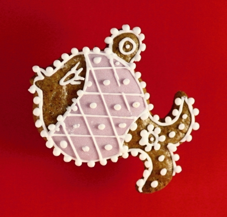 Christmas fish made by gingerbread on red background Stock Photo