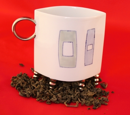 Cup with leaf tea on red background Stock Photo