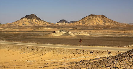 Hills in Black desert with yellow and black sand,Egypt