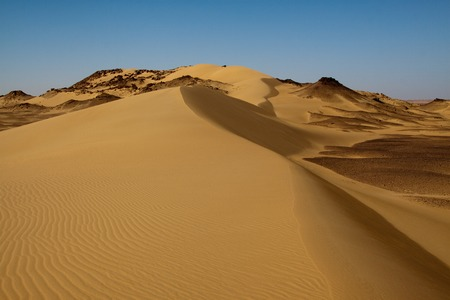 Sahara desert landscape with dunes and hills Stock Photo