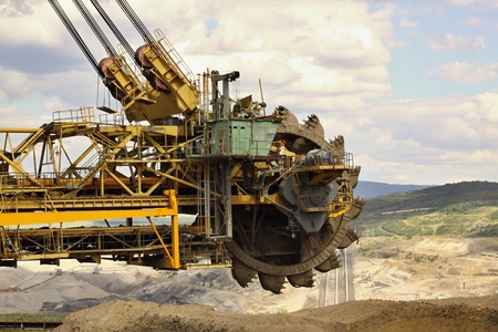 uncovering: uncovering of the soil on the mine for brown coal,huge coal mining  machine Stock Photo