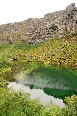 Beautiful lake with green water in Iceland