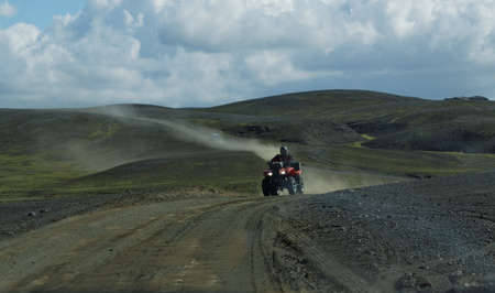 Landscape with mountains  and the four wheeler vehicle in Iceland Stock Photo