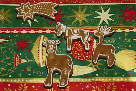 decorated christmas gingerbread on a christmas color  background