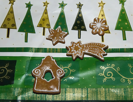 decorated christmas gingerbread on a christmas color background Stock Photo