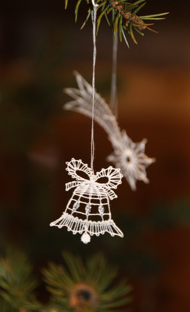 bobbin lace christmas ornament-bell and the comet in the background Stock Photo