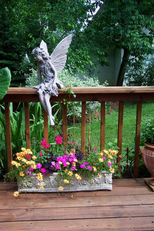 A beautifully decorated deck garden. photo