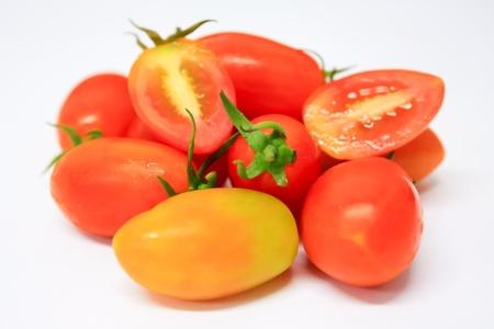 fresh cherry tomatoes on white background III Stock Photo