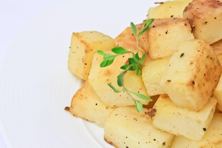 potato cut into dice roasted with salt and pepper III Stock Photo