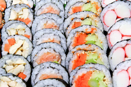 Sushi just completed are arranged on the plate beautifully photo