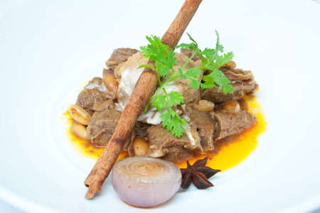 fragrant cinnamon and anise scented curry, slow cooked pork photo