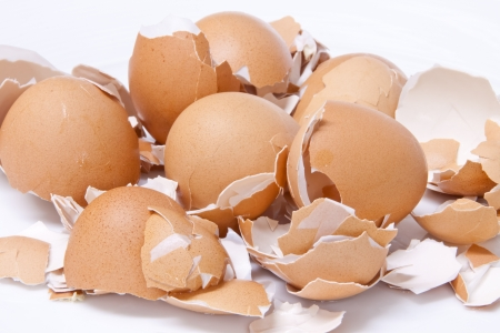 Fresh eggs shell  scattered on a white background Stock Photo