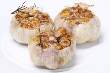 Fresh garlic with rosemary grilled and smoked until fragrant