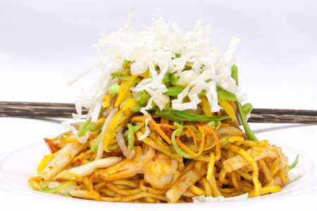 Korean food egg noodle fried with prawn and vegetables photo