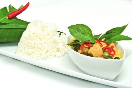 green curry with chicken and eggplant garnish with basil leaves Stock Photo