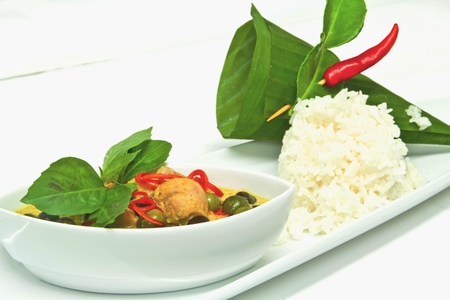 green curry chicken with eggplant garnish with basil leaves