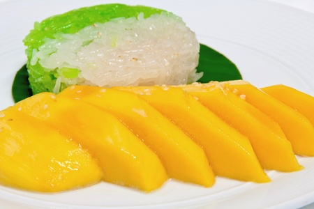 sweet sticky rice with mango topping with coconut milk photo
