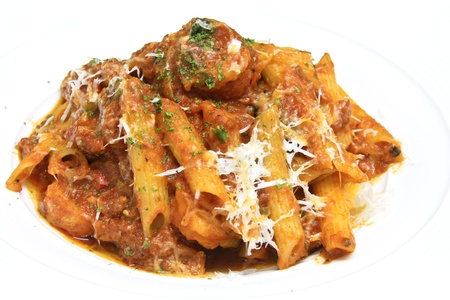 penne italian pasta with tomato sauce and parmesan cheese Stock Photo