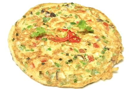 Thai omelet with tomato and onion garnish with red chili and coriander leaf Stock Photo
