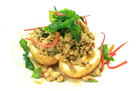 Fried chicken with chili and basil leave on top boiled eggs decorate with deep-fried basil leaves