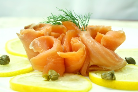 smoked salmon slice with lemon slice decorate with dill