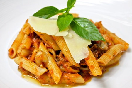 Penne italian pasta with tomato sauce and parmesan cheese photo