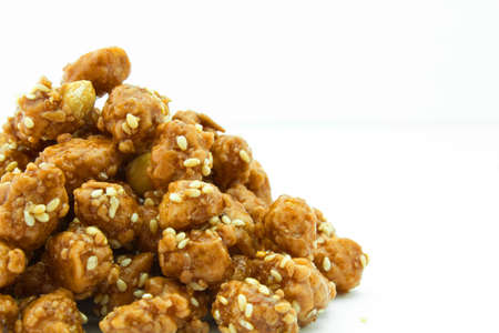 Peanuts mix with sugar sprinkle with sesame seeds