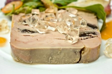 Sliced foie gras with sauce and vegetable leaf Stock Photo