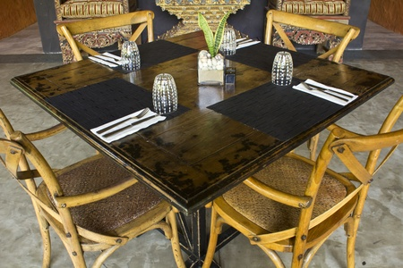 Wooden tables and chairs for dinner