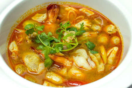 Thai cuisine soup tom yum goong photo