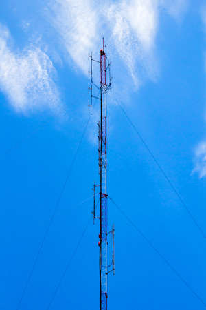 A communications tower on sky blackground photo