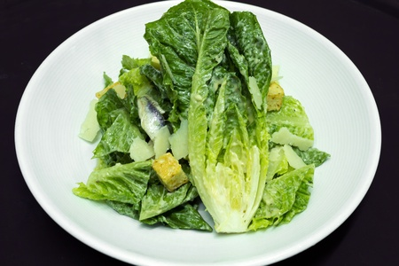 Caesar salad with parmesan cheese and crouton photo