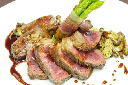 Beef steak with fried mushrooms and sauce photo