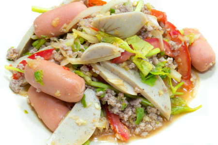 The spicy pork salad with tomato and thai celery photo