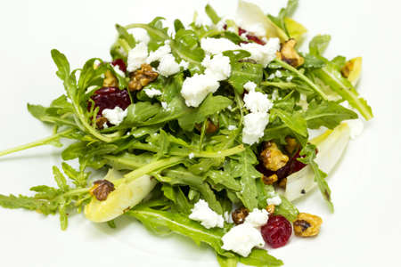 Chicory and organic rocket salad and goat cheese photo