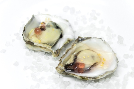 Oysters with caviar on a white background