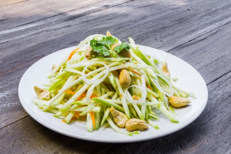 Green mango salad with carrot and cashew nuts Stock Photo - 14579912