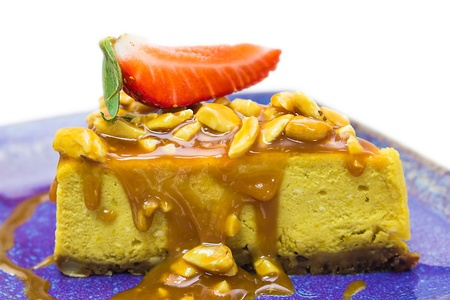 Pumpkin pie with caramel and cashew nuts photo