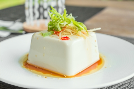 bean curd: Silken tofu with gochujang and sesame oil decorate with spring onion and ginger