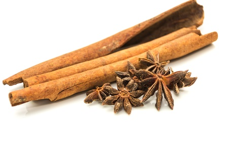 Cinnamon sticks and anise stars on white  background photo