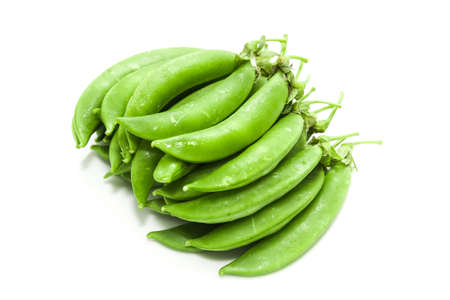 Sugar snap peas on white background photo