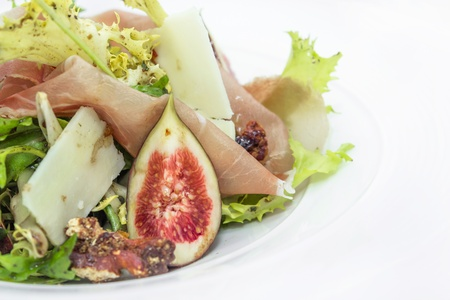Salad of Chicory Walnuts, cheese  parma ham and fig photo