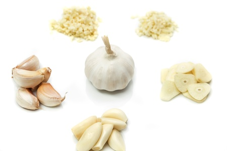 fresh garlic: Prepare garlic for cooking on white background