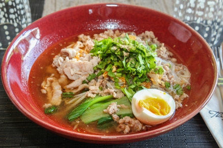Thai noodle soup with pork and egg Stock Photo
