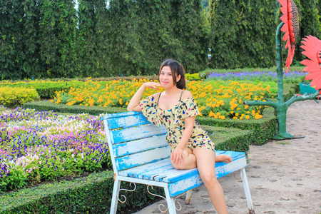 asian woman sitting on the blue chair photo