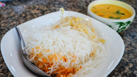 Rice noodle with crab curry photo