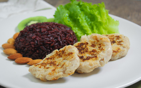 Grilled chicken with riceberry rice and romaine lettuce Stock Photo